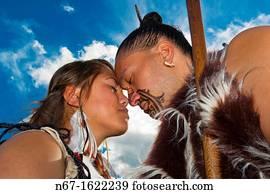 335effbf1 A Maori man with ta moko facial tattoo and woman doing hongi traditional  Maori greeting,