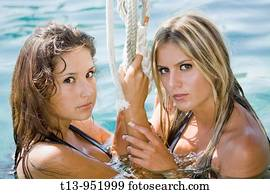 40565155e8 Two young girls and boys in swimsuits in field holding water pistols ...