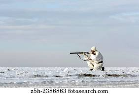 e5814cc1078f2 Russian Federation. Voronezh oblvst. Hunter in camouflage white suit on winter  hunting.