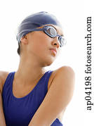 Young woman in swimming cap and goggles, head shot