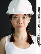 Young woman wearing hard hat