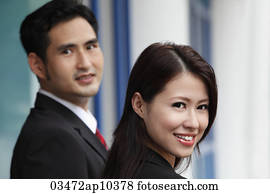 head shot of man and woman smiling