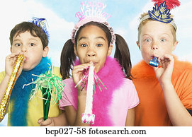 Boys and girl in party hats