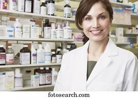 Female pharmacist smiling in pharmacy
