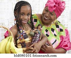 African American girl and grandmother in traditional clothing