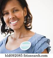 Black woman wearing volunteer badge