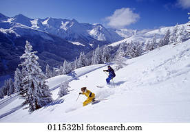 couple skiing in winter landscape