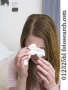 crying young woman holding tissue