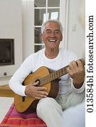 portrait of mature man playing guitar