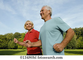 woman looking at man while running through park