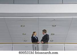 two executives having conversation in office building