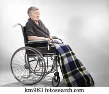 1960s Sad Depressed Elderly Woman In Wheelchair Stock