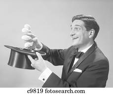 03f5d3b8512 1960S Profile Magician Man Pulling 4 Eggs Out Of Hat Holding Them Between  Fingers