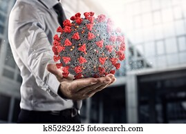 Businessman holds a bic bacteria of covid 19 ready to be examined in hospital