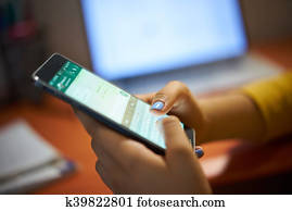 Girl Typing Phone Message On Social Network At Night