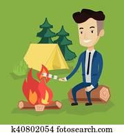 Businessman Roasting Marshmallow Over Campfire