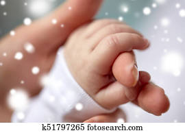 close up of mother and newborn baby hands