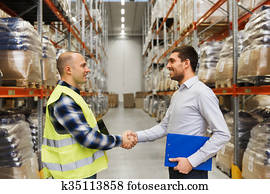 worker and businessmen with clipboard at warehouse