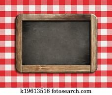 chalkboard or blackboard on picnic tablecloth