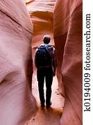 Hiker in slot canyon