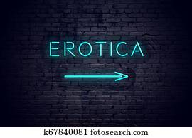 Brick wall with neon arrow and sign erotica