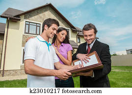 Young man signing renting contract with real estate agent. agent holding documents to sign agreement for house sale