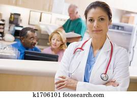 Doctors And Nurses At The Reception Area Of A Hospital