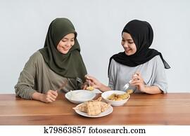 woman enjoy ketupat and opor ayam