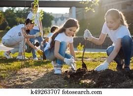 Adolescents working in volunteer group