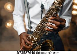 Male jazz performer plays the saxophone on stage