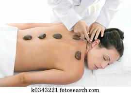 Female receiving a relaxing massage treatment
