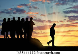 Silhouettes of people crowd expel the man from their community.