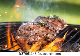 Beef steaks on grill