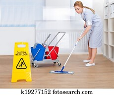 Happy Maid Cleaning Floor With Mop
