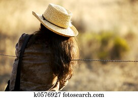 Cowgirl at the Fence