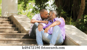 Gay People Two Men Kissing On Stairs In Park