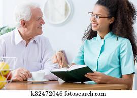Caregiver keeping senior man company