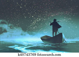 man rowing a boat in the sea