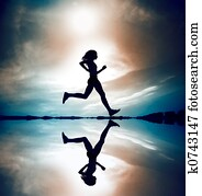 Runner Silhouetted Reflec