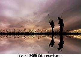 child fishing with his dad