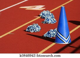 Cheerleader pom poms and megaphone