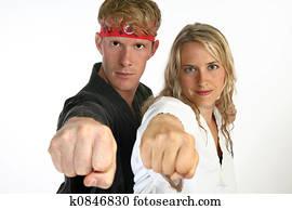Martial arts man and woman punching