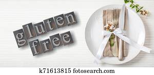 Gluten-free text and cutlery on a plate, white wood background, 3d illustration