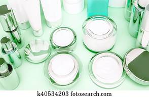 Skin care products on green.