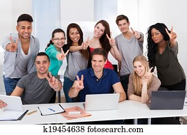 College Students Gesturing Victory Sign Together