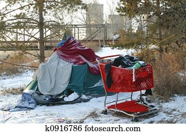 homeless person's tent and shopping cart