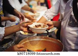 Volunteers provide food for beggars : Concepts Feeding and help : Concept of food sharing for the poor to alleviate hunger : Volunteers Share Food to the Poor