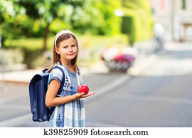 bb5155ef7161 Pretty little 9 year old girl walking back to school, wearing blue vintage  backpack,