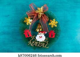 Christmas decoration with christmas wreath. Blue background.