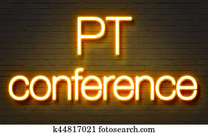PT conference neon sign on brick wall background.